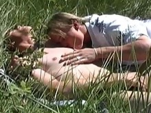 These two boys are up for some outdoor fun in the sun, as they roll around in the grass and explore each others bodies. They suck and fuck each other