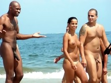 Young nudist friends naked together at the beach